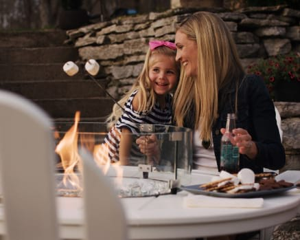 Mother and child enjoy POLYWOOD fire pit table